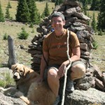 Sandy and Cooper at a rock cairn on the Colorado Trail.