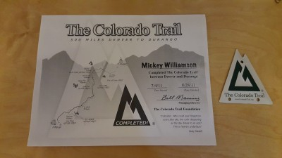 Colorado Trail completion certificate and metal logo